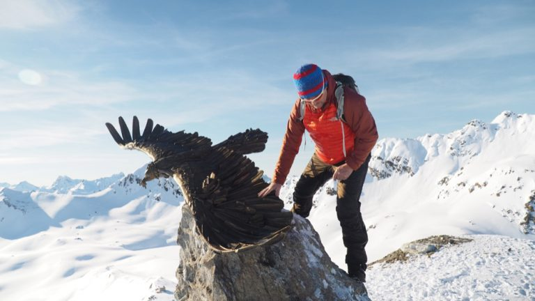 Artist Walter File with his sculpture in the Alps